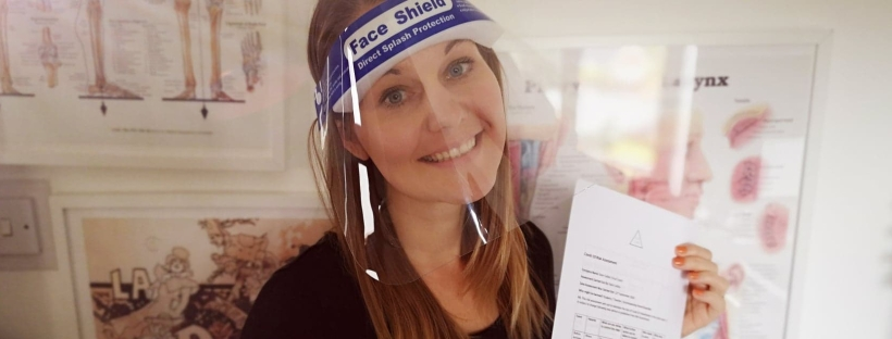 Kate in a visor with a risk assessment for singing lessons face to face in Cheshire